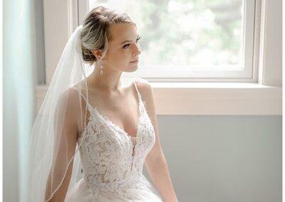 Bride framed in Window
